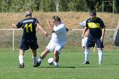 Senior soccer game — Stock Photo