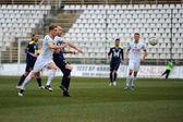 KAPOSVAR, HUNGARY - MARCH 16: Kink Tarmo (white 9) in action at a Hungarian Championship soccer game - Kaposvar (white) vs Puskas Akademia (blue) on March 16, 2014 in Kaposvar, Hungary. — Stockfoto