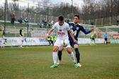KAPOSVAR, HUNGARY - MARCH 16: Firtulescu Dragos Petrut (white 10) in action at a Hungarian Championship soccer game - Kaposvar (white) vs Puskas Akademia (blue) on March 16, 2014 in Kaposvar, Hungary. — Stock Photo