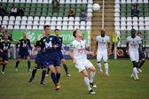 KAPOSVAR, HUNGARY - MARCH 16: Kink Tarmo (white 9) in action at a Hungarian Championship soccer game - Kaposvar (white) vs Puskas Akademia (blue) on March 16, 2014 in Kaposvar, Hungary. — Stock Photo