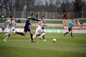 KAPOSVAR, HUNGARY - MARCH 16: Florean Andrei-Alexandru  (white) in action at a Hungarian Championship soccer game - Kaposvar (white) vs Puskas Akademia (blue) on March 16, 2014 in Kaposvar, Hungary. — Stockfoto