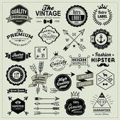 Collection of vintage labels, arrows, ribbons, symbols and design elements — Stock Vector