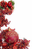 Red christmas frame of berries with filigree on ball — Stock Photo