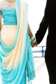 Indian bride and groom walking away together — Stock Photo