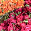 Roses in a Basket for Sale in India - Stock Photo