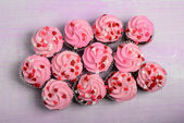 Pink Cupcakes on a Wood Background — Stock Photo