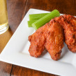 Chicken Buffalo Wings and a Beer — Stock Photo