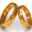 Two gold rings tilted at each other — Stock Photo