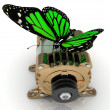 Big green butterfly sits on a pulley gold generator - Stock Photo