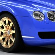 Premium blue car with gold wheels — Stock Photo #25622245