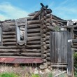 Stock Photo: Old destroyed wooden house