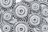 Set of steel cogwheels on a white background. — Stock Photo