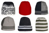 Collection of winter knitted woolen hats on a white background. — Stock Photo