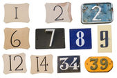 Collection of House numbers on the wall — Stock Photo