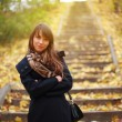 Pretty girl in autumn park — Stock Photo