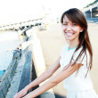 Smiling girl on quay — Stock Photo