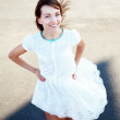Stock Photo: Young lady in white dress