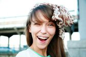 Winking woman with kerchief — Stock Photo