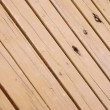 Leaned wood grain background — Stock Photo