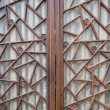 Carved wooden window in the door — Stock Photo