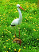 Stork sculpture on the spring meadow — Stock Photo