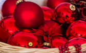 Red Christmas balls in basket — Stock Photo