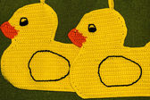 Crochet potholder, yellow ducks — Stock Photo