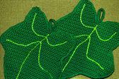 Crochet potholder, green leaves — Stock Photo