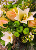 Beautiful arrangement with roses and lilies — Stock Photo