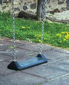 The childrens swing — Stockfoto