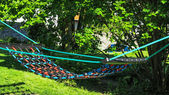 Colorful hammock between the trees — Stock fotografie