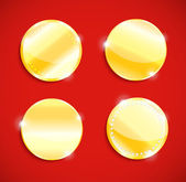 Set of blank round polished gold metal badges — 图库矢量图片