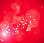 Valentine's red background with sparkles and hearts — Stock Vector