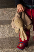 Teddy in the hands of a child — Stock Photo