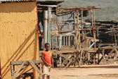 Boy in shanty town — Stock Photo