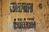 Textured Grunge Wall Background with Graffiti — Stock Photo