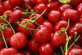 Lots of red cherries — Stock Photo