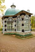 Stone bird house in the park — Stock Photo