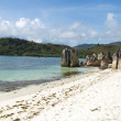 White sandy beach in Seychelles, Denis private island, Indian Ocean - Stock Photo