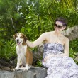 Portrait of a woman with her beautiful dog lying outdoors — Stockfoto