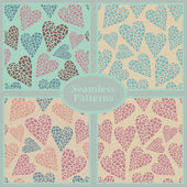 Romantic seamless patterns with hearts — Stock Vector