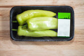 Green Sweet Pepper wrapped in package — Stock Photo