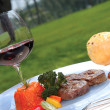 Beefsteak and red wine - Stock Photo