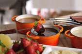 Fondue with strawberry and chocolate — Stock Photo