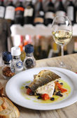 Grilled fish and white wine — Stock Photo