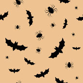 Seamless pattern with bats and spiders — Stock Vector