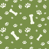 Background with dog paw print and bone on green — Stock Vector