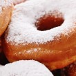 Stock Photo: Powdered sugar donuts
