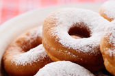 Powdered sugar donuts — Stock Photo