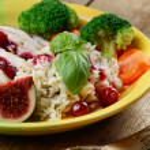 Chicken breast under cranberry sauce — Stock Photo